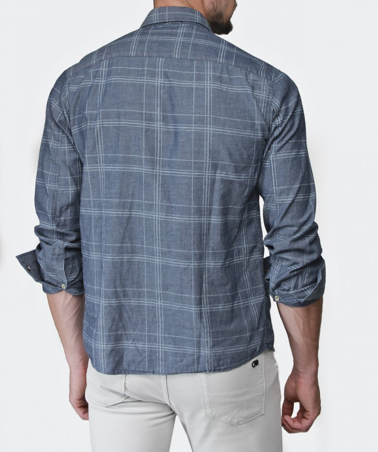 The checked shirt is a modern day menswear essential that almost every man - no matter your age, style or profession - owns. However, this popularity has led to the piece being worn in the most unimaginative and uninspiring ways possible.